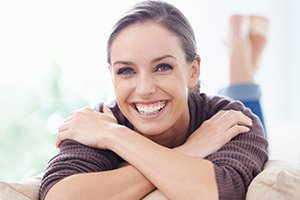 Woman on couch with brilliant white smile