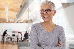 Mature woman smiling in office