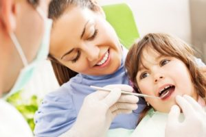 Woman and child at dentist