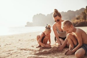parent building sandcastle with children