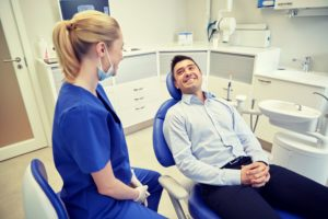 man smiling at emergency dentist in Lewisville