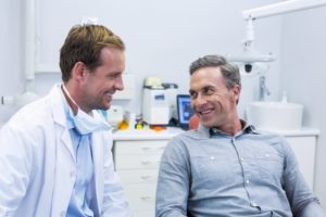 Man happily talks with his friendly Lewisville dentist