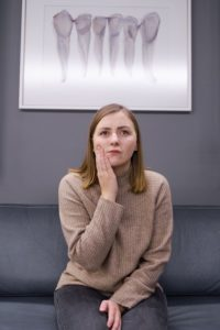 Woman at dentist with a dental emergency